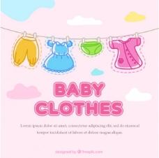 可爱的婴儿衣服挂在绳子上的背景