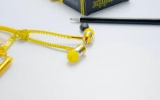拉链耳机 耳机 黄色 摄影 J图片